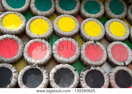 colorful bright wall disk or disc decoration in round or circle shape green red yellow and black color as abstract background with no people
