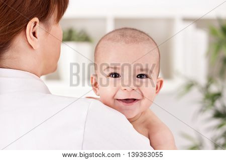 Doctor Pediatrician Holding Cute Baby