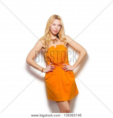 Fashion Model Girl Portrait In Orange Short Dress And Modern Accessories