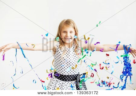 Little Girl Jumping And Having Fun Celebrating Birthday.