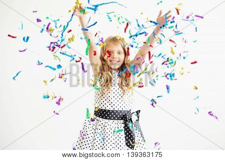 Portrait Of A Child Throws Up Multi-colored Tinsel And Confetti