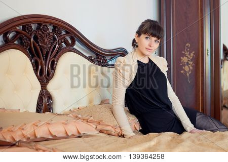 Portrait of young beautiful fashionable woman in the interior