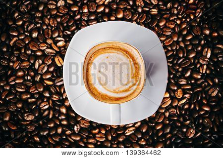 Hot Coffee and with clock sign in white cup Glittering of coffee beans vintage and vignete tone