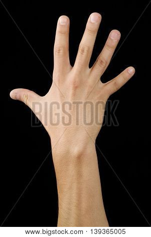 Hand five fingers signal in a black backgrownd