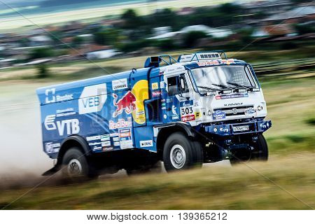 Filimonovo Russia - July 11 2016: rally KAMAZ truck rides a dusty road during Silk way rally