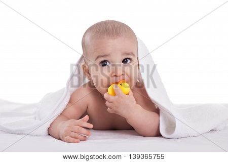 Adorable Baby Holding And Bites Yellow Duck After Shower