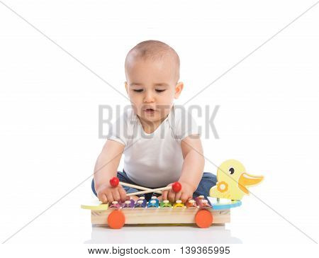 Adorable baby enjoy and playing percussion isolated