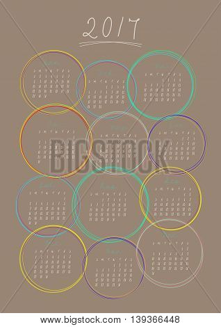 Vector Of Calendar 2017 Year ,12 Month Calendar With Coloful Circle Frame On Pale Brown Background ,