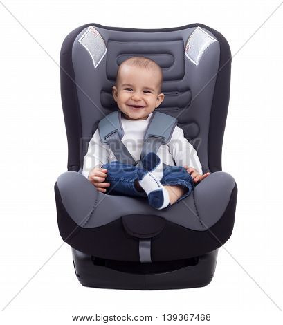 Smiling infant baby child sitting in a car seat isolated on white