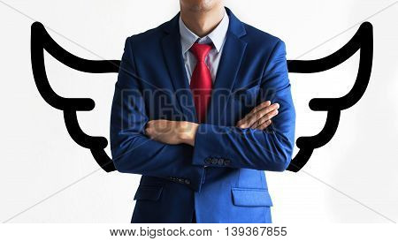 Confident Business Man In The Suit With Arms Fold On The Chest With Wings.