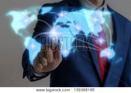 Businessman Touching Blue Virtual World Map On Screen With Connecting Light Between Continents