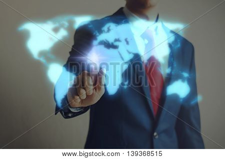 Businessman Touching Blue Virtual World Map On Screen