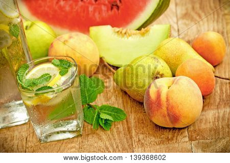 Refreshment in hot days of summer - fruit juice and fresh organic fruits