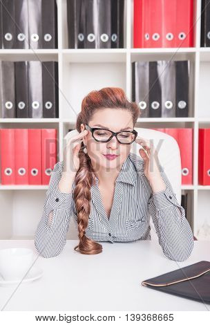 Business Woman With Headache In Office