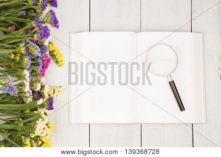 Beautiful Colorful Flowers, Open Blank Book And Magnifying Glass
