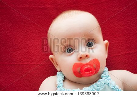 Portrait of Cute baby with pacifier in her mouth