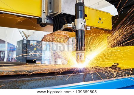 plasma or laser cutting metalwork. Technology of flat sheet metal steel material processing with sparks