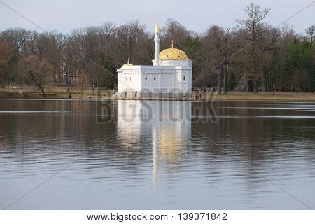 SAINT PETERSBURG, RUSSIA - APRIL 17, 2016: The Turkish bath pavilion on the Great pond of the Catherine park, cloudy april day. Historical landmark of the Tsarskoye Selo