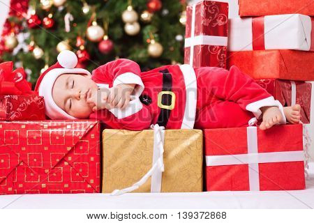 Beautiful Baby Child In Santa Costume Sleeping