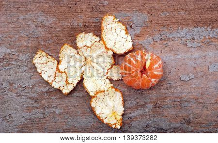 picture of a Peeled Slices of Orange on wood cement backgrounds group
