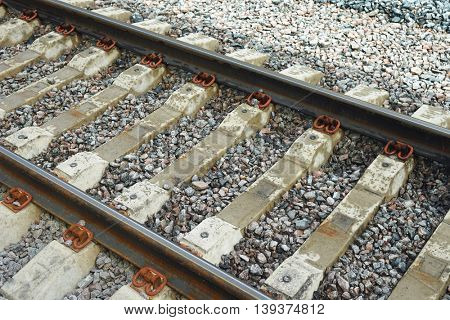 The railroad tracks close-up. Horizontal image diagonal form.