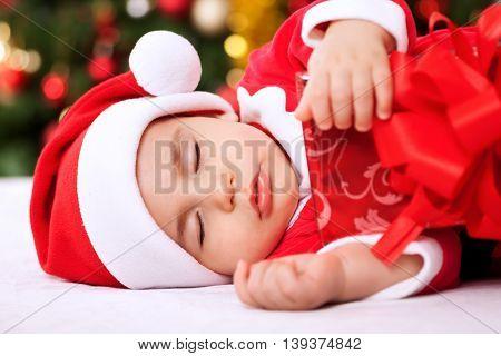 Sleeping Baby Child Santa Holding Gifts