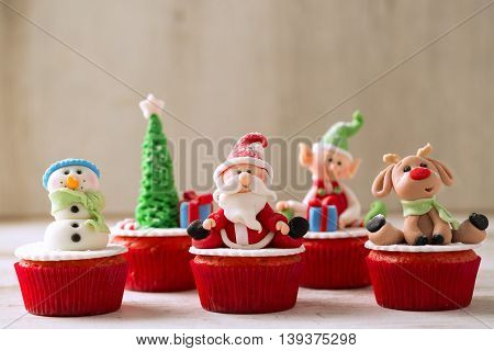 Christmas cupcakes on wood background, christmas concept