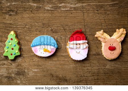 Traditional festive cute cookies christmas concept on wooden background