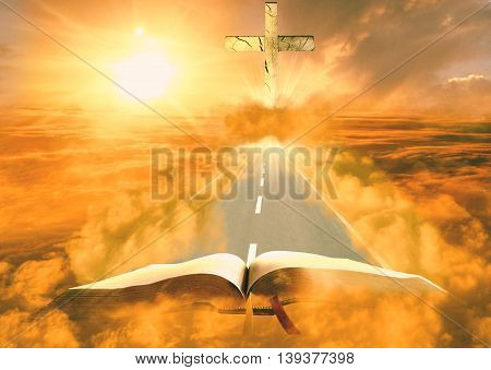 Bible on clouds with cross on road way out of it