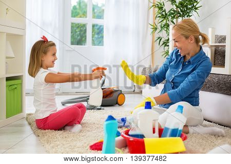 Family cleaning room and having fun at home