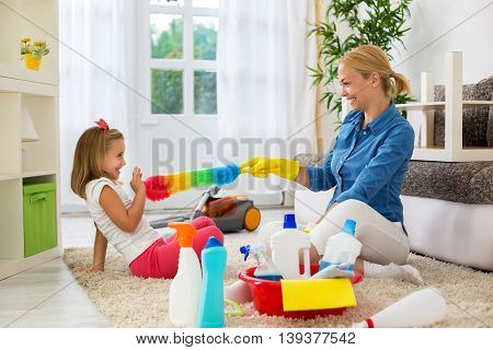 Mother And Her Daughter Ready To Cleaning Room