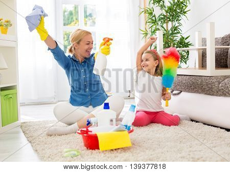 Cute Mother And Her Daughter Ready To Cleaning Room