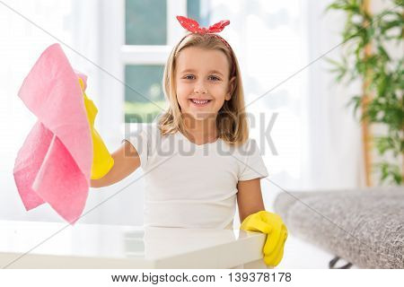 Young Worth Little Girl Helping Mother To Cleaning Home