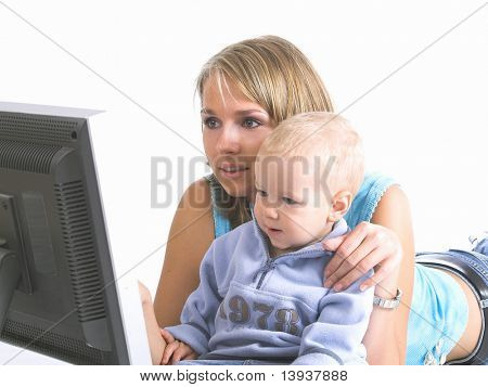 Mother with little boy look on laptop