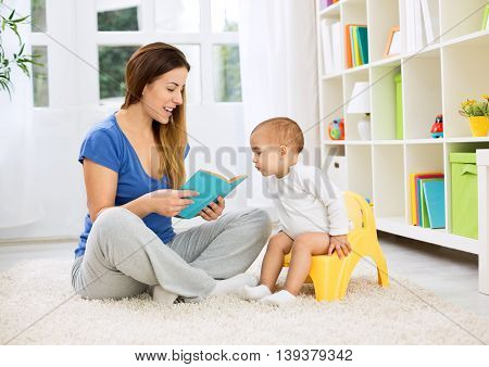 Cute Baby Sitting On Bedpan And Listening Kid Story