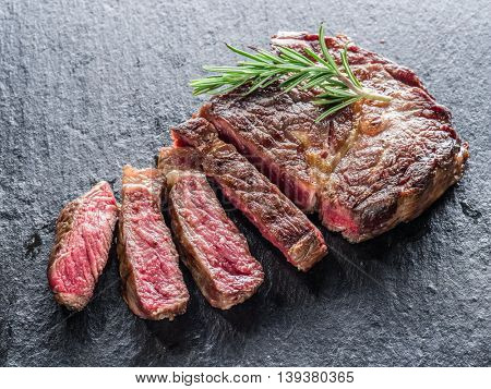 Medium Ribeye steak on the graphite tray.