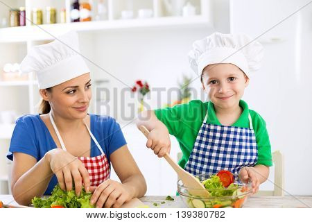 Mom And Kid Cooking Together