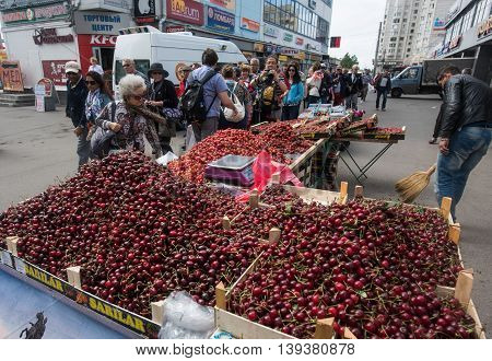 Saint-Petersburg Russia - June 22 2016: Sale of cherries and other berries on a city street. Spontaneous trade in the city center near the metro station.