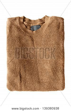 Folded brown pullover isolated over white background