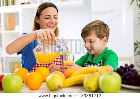 Mother Cuttle Orange Juice To Her Child