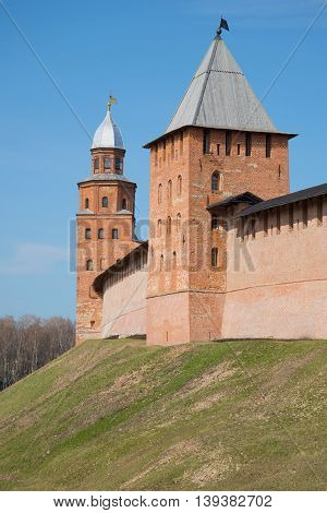 Two ancient towers in the Novgorod fortress close up, sunny april day. Veliky Novgorod, Russia