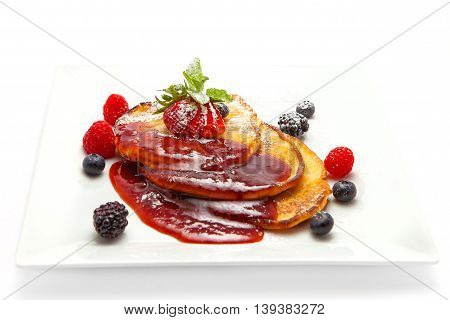 Three Pancake with sugar jam and fruit decorations mint