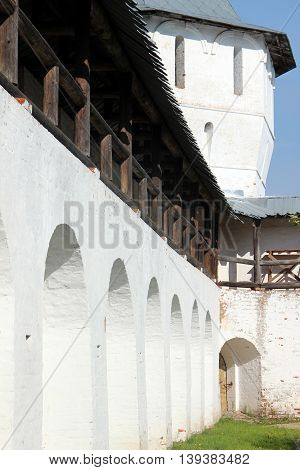 Arcade of the ancient courtyard of Spaso-Prilutsky Monastery at summer sunny day in in the Vologda, Russia. Castle defense wall