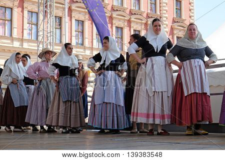 ZAGREB, CROATIA - JULY 21: Members of folk group Escola de ball de bot Calabruix from Mallorca, Spain during the 50th International Folklore Festival in center of Zagreb, Croatia on July 21, 2016