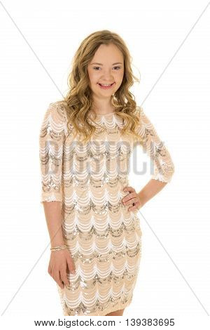 A woman with down syndrome in her dress with her hands on her hip.