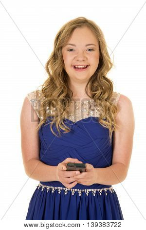 a woman with down syndrome laughing while she sends a text.