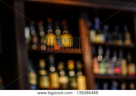 Blurred Of Wine Bottles. Blurred Image Of Bottles Of Wine On The Shelves In Market..
