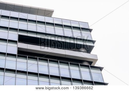 Extreme Close Up Building Windows. Low Angle View Of Modern Commercial Office Building With Vertical