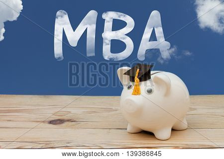 Getting your MBA A white piggy bank with grad cap on weathered wood with sky background with text MBA