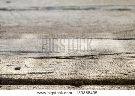 Old gray wooden surface with a sharp foreground and blurred background